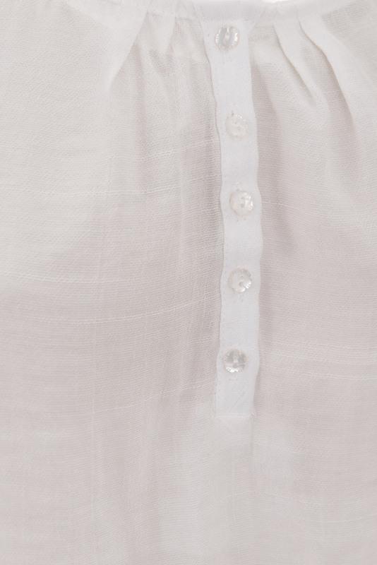 bluzka biała prześwitująca z guzikami przy dekolcie